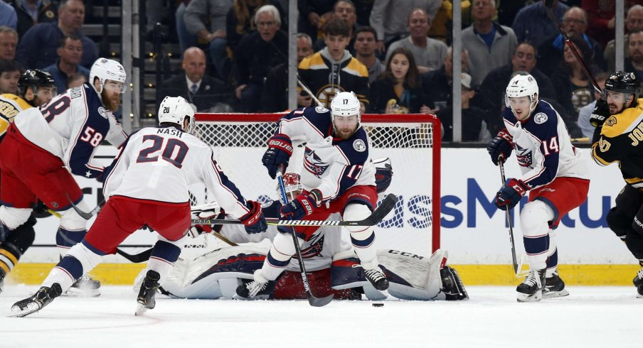 Apr 25, 2019; Boston, MA, USA; Columbus Blue Jackets center Brandon Dubinsky (17) clears the puck away from goaltender Sergei Bobrovsky (72) against the Boston Bruins during the first period in game one of the second round of the 2019 Stanley Cup Playoffs at TD Garden.