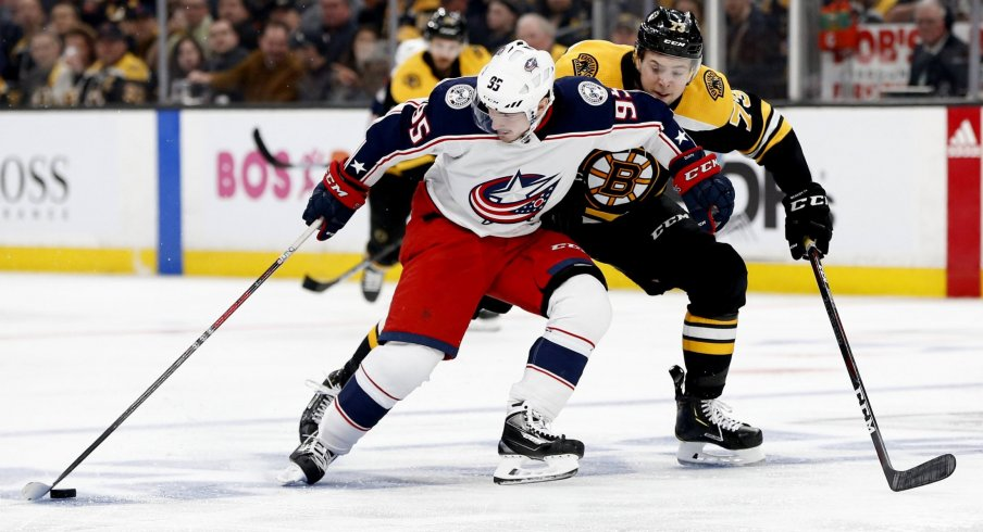 Apr 25, 2019; Boston, MA, USA; Columbus Blue Jackets center Matt Duchene (95) controls the puck against Boston Bruins defenseman Charlie McAvoy (73) during the third period in game one of the second round of the 2019 Stanley Cup Playoffs at TD Garden.