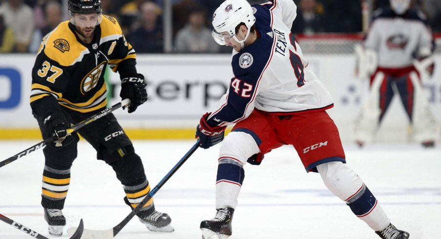 Columbus Blue Jackets center Alexandre Texier (42) battles with Boston Bruins center Patrice Bergeron (37) during the first period in game one of the second round of the 2019 Stanley Cup Playoffs at TD Garden.