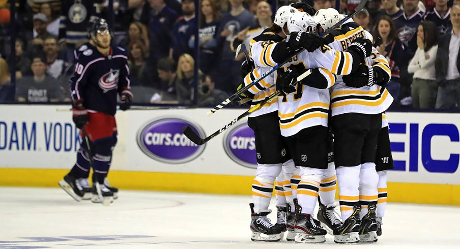 Patrice Bergeron celebrates with his Bruins teammates after scoring to put Boston up 2-0 on Columbus in Game 4.