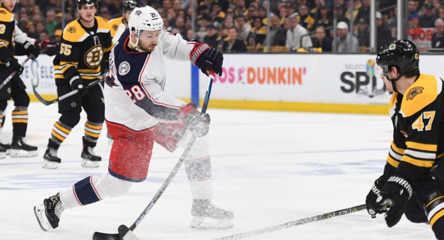 Apr 27, 2019; Boston, MA, USA; Columbus Blue Jackets right wing Oliver Bjorkstrand (28) shoots the puck while Boston Bruins defenseman Torey Krug (47) defends during the first period in game two of the second round of the 2019 Stanley Cup Playoffs at TD Garden.