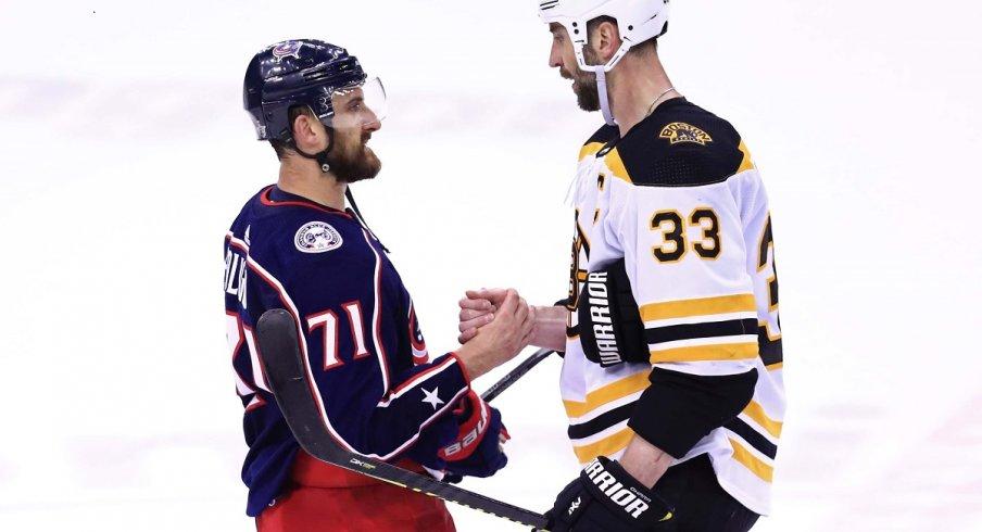 Nick Foligno shakes hands with Boston Bruins defenseman Zdeno Chara