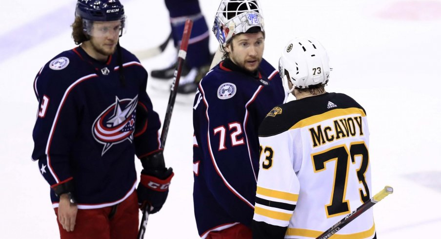 Columbus Blue Jackets goaltender Sergei Bobrovsky (72) shakes hands with Boston Bruins defenseman Charlie McAvoy (73) after game six of the second round of the 2019 Stanley Cup Playoffs at Nationwide Arena.