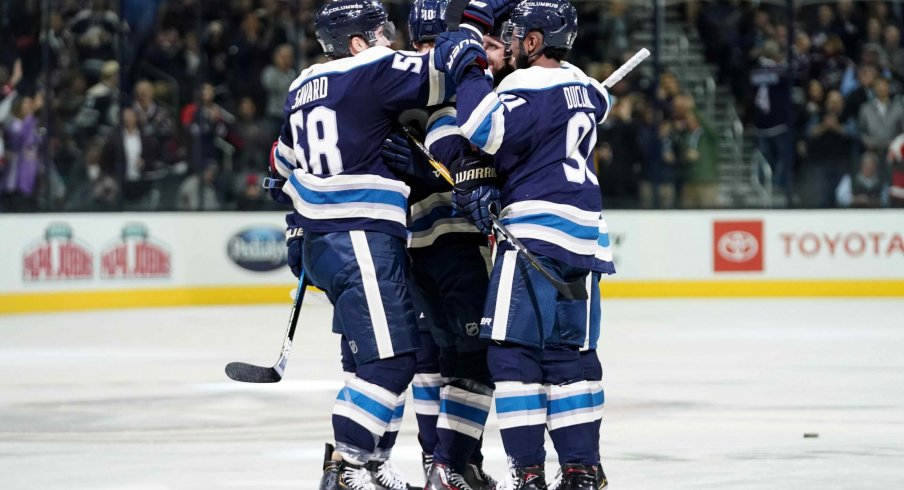 Oct 18, 2018; Columbus, OH, USA; Columbus Blue Jackets left wing Nick Foligno (back right) celebrates with teammates defenseman David Savard (58) and left wing Anthony Duclair (91) after scoring a goal against the Philadelphia Flyers in the second period at Nationwide Arena.
