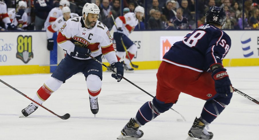Florida Panthers captain Derek MacKenzie (17) skates with the puck against his former team, the Columbus Blue Jackets, during a game at Nationwide Arena.