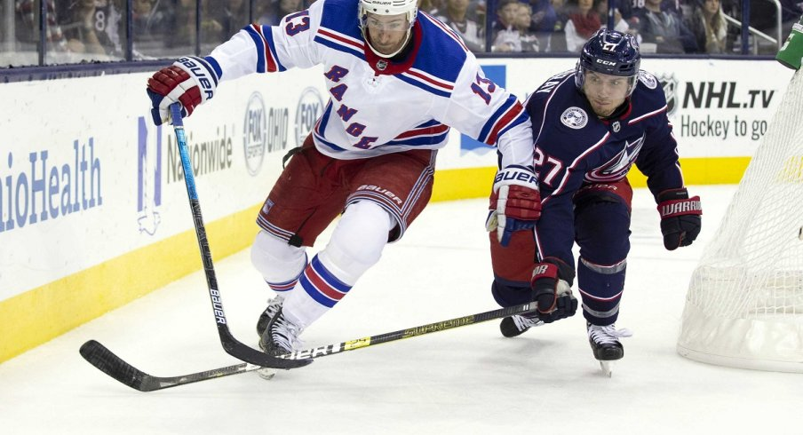 Kevin Hayes and Ryan Murray battle for the puck at Nationwide Arena