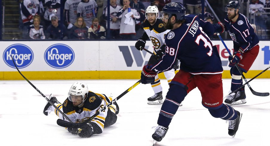 Apr 30, 2019; Columbus, OH, USA; Columbus Blue Jackets center Boone Jenner (38) scores a goal on a shot against Boston Bruins defenseman Connor Clifton (75) in the first period during game three of the second round of the 2019 Stanley Cup Playoffs at Nationwide Arena.