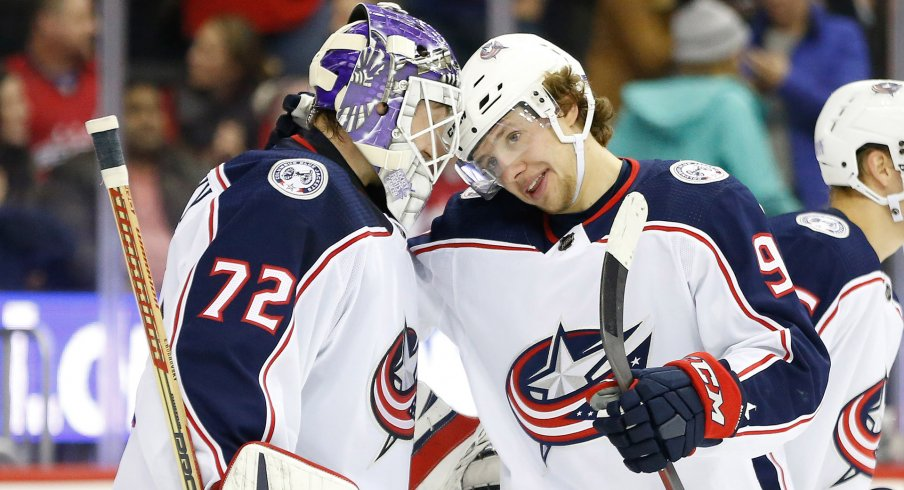 Columbus Blue Jackets goaltender Sergei Bobrovsky (72) celebrates with Blue Jackets left wing Artemi Panarin (9) after their game against the Washington Capitals at Capital One Arena.