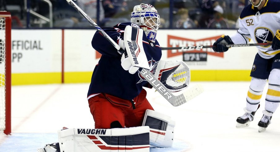 Columbus Blue Jackets goaltender Matiss Kivlenieks (80) makes a save in net against the Buffalo Sabres in the first period at Nationwide Arena