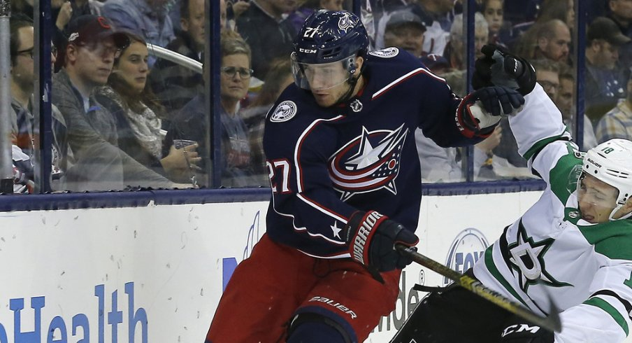 Columbus Blue Jackets defenseman Ryan Murray battles along the boards against the Dallas Stars during a game in November of 2018