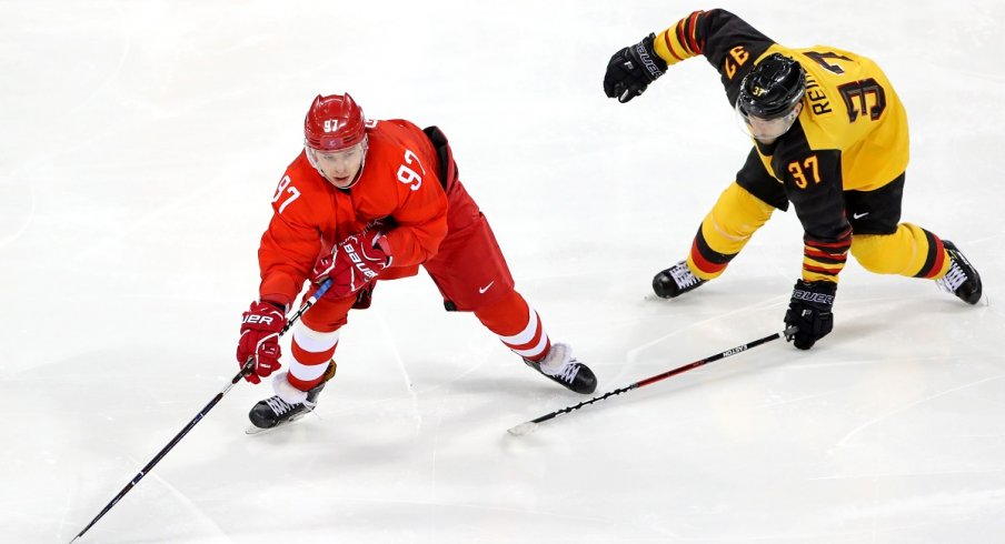 Nikita Gusev stickhandles for OAR in the Gold Medal hockey game against Germany