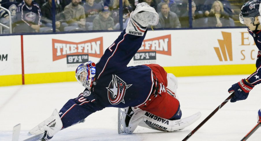 Columbus Blue Jackets goaltender Joonas Korpisalo attempts to stop the puck from entering the net against the Montreal Canadiens during a regular-season matchup at Nationwide Arena in January of 2019.