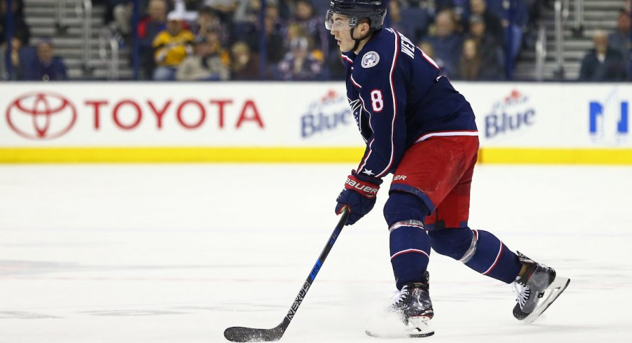 Blue Jackets defenseman Zach Werenski carries the puck up the ice during a game at Nationwide Arena.