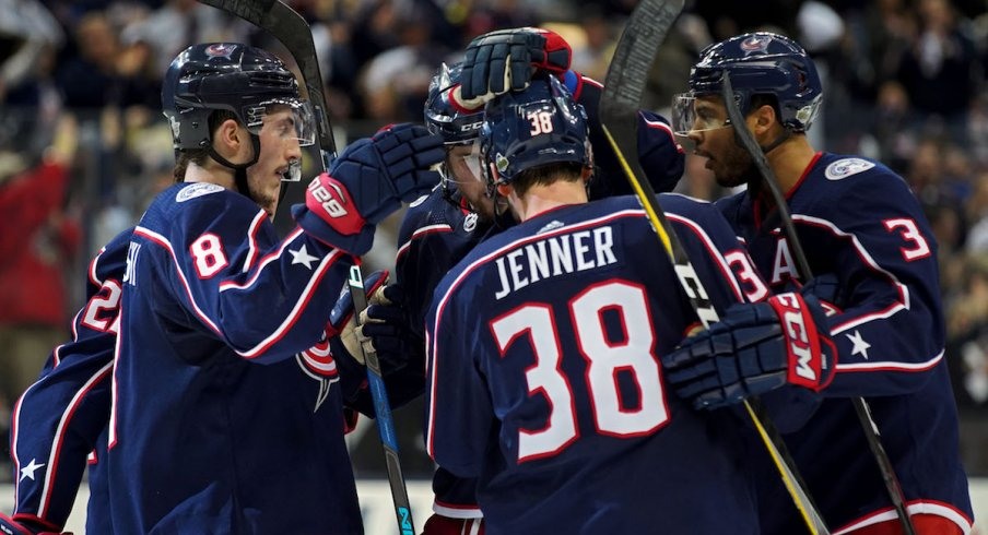 The Blue Jackets celebrate a goal scored by Boone Jenner during a game at Nationwide Arena.
