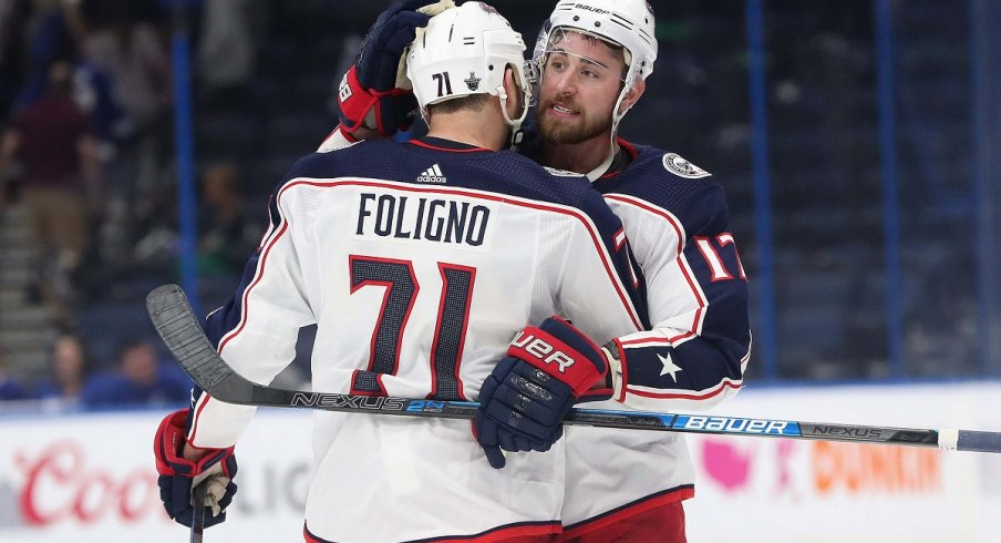 Nick Foligno and Brandon Dubinsky celebrate a road win against the Tampa Bay Lightning