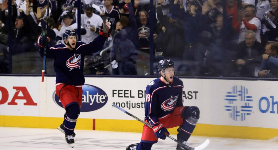Apr 16, 2019; Columbus, OH, USA; Columbus Blue Jackets right wing Oliver Bjorkstrand (left) reacts to the goal scored by center Pierre-Luc Dubois (right) against the Tampa Bay Lightning in the first period during game four of the first round of the 2019 Stanley Cup Playoffs at Nationwide Arena.