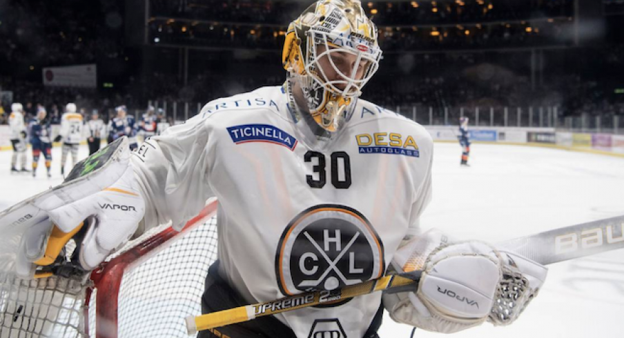 Blue Jackets goaltender Elvis Merzlikins looks on during a game with HC Lugano.