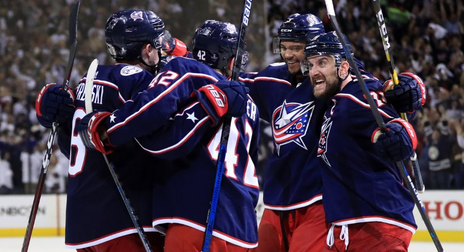 Columbus Blue Jackets defensemen Zach Werenski and Seth Jones celebrate with forwards Alexandre Texier and Nick Foligno during Game 4 of the first round of the 2019 Stanley Cup Playoffs at Nationwide Arena against the Tampa Bay Lightning.