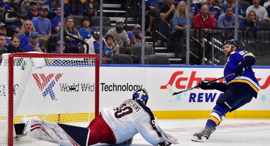 St. Louis Blues defenseman Alex Pietrangelo (27) scores against Columbus Blue Jackets goaltender Elvis Merzlikins (90) during the second period at Enterprise Center.