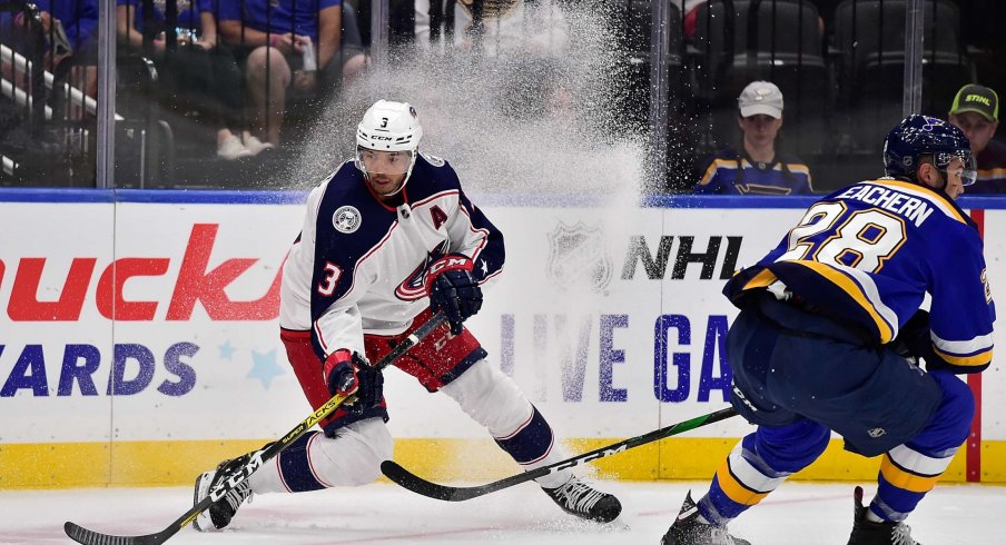 Sep 22, 2019; St. Louis, MO, USA; Columbus Blue Jackets defenseman Seth Jones (3) handles the puck as St. Louis Blues left wing Mackenzie MacEachern (28) defends during the second period at Enterprise Center.