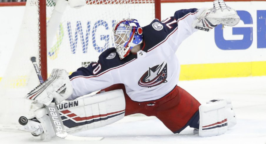 Columbus Blue Jackets goaltender Joonas Korpisalo makes a save in a regular-season matchup against the Washington Capitals at Capital One Arena in January of 2019.
