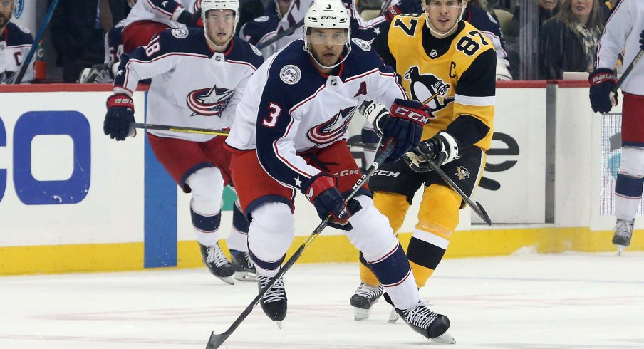 Columbus Blue Jackets defenseman Seth Jones (3) skates up ice with the puck ahead of Pittsburgh Penguins center Sidney Crosby (87) during the first period at PPG PAINTS Arena.
