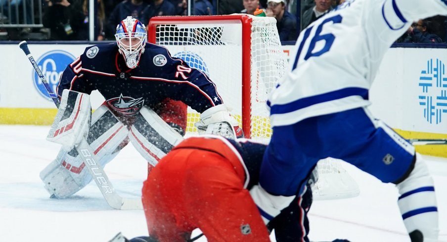 Columbus Blue Jackets goaltender Joonas Korpisalo (70) defends the net against the Toronto Maple Leafs in the first period at Nationwide Arena.