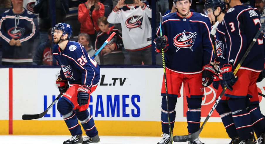 Columbus Blue Jackets right wing Oliver Bjorkstrand (28) celebrates with teammates after scoring a goal against the Buffalo Sabres in the first period at Nationwide Arena.