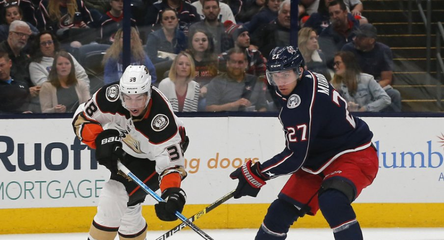 Columbus Blue Jackets defenseman battles for the puck in a regular-season matchup with the Anaheim Ducks at Nationwide Arena during October of 2019.