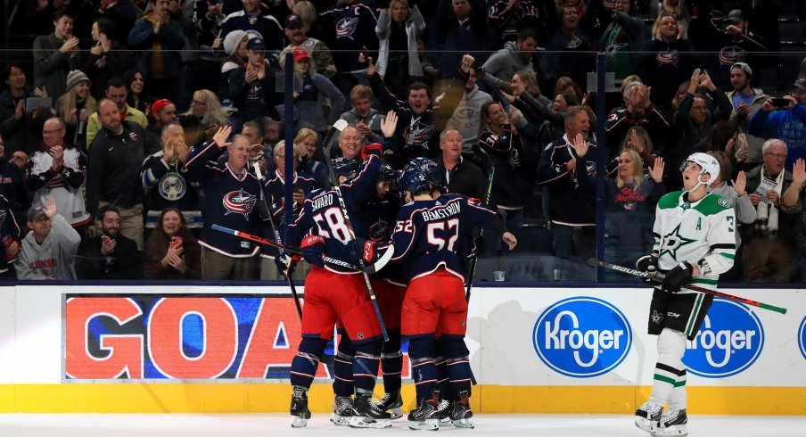 Oct 16, 2019; Columbus, OH, USA; Columbus Blue Jackets center Alexander Wennberg (10) celebrates with teammates after scoring a goal against the Dallas Stars in the first period at Nationwide Arena.