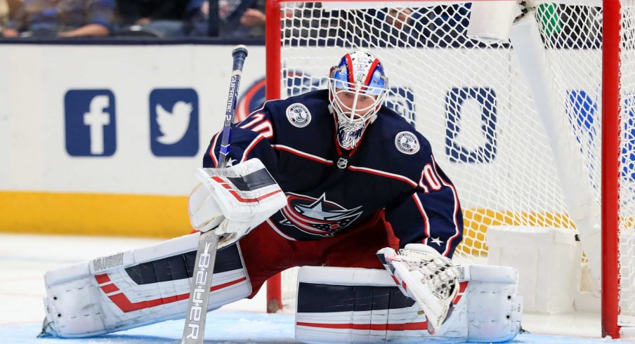 Oct 16, 2019; Columbus, OH, USA; Columbus Blue Jackets goaltender Joonas Korpisalo (70) dives to make a save in net against the Dallas Stars in the second period at Nationwide Arena.