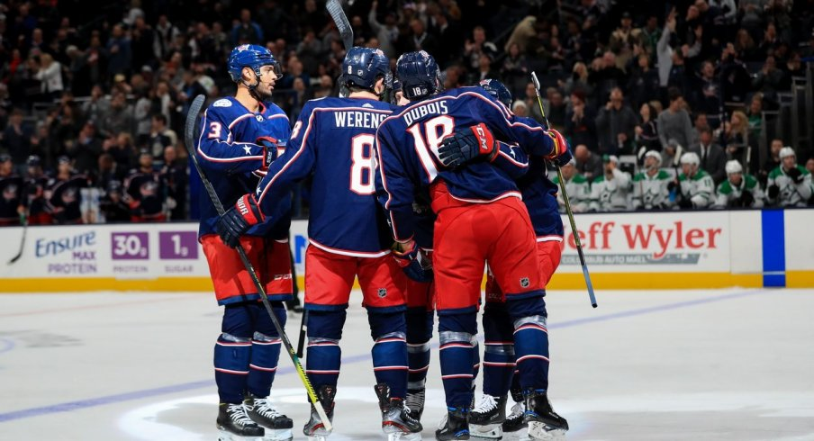 Columbus Blue Jackets defenseman Zach Werenski (8) celebrates with teammates after scoring a goal against the Dallas Stars in the first period at Nationwide Arena. Mandatory Credit: Aaron Doster-USA TODAY Sports
