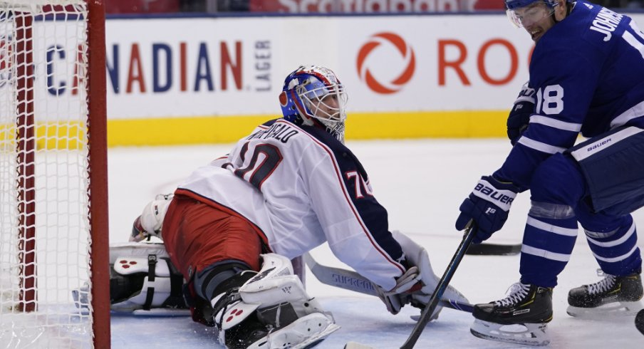 Columbus Blue Jackets goaltender Joonas Korpisalo spreads out to make a save against Andreas Johnsson of the Toronto Maple Leafs during a regular-season matchup during October of 2019.