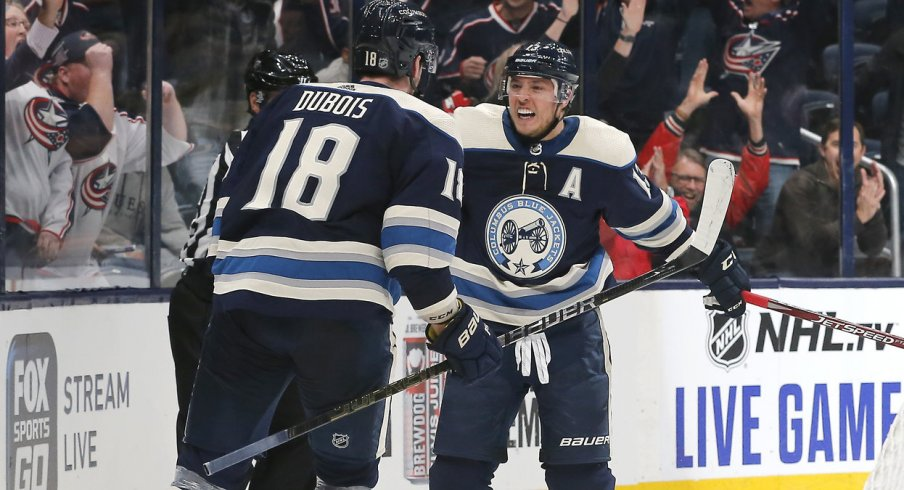 Oct 24, 2019; Columbus, OH, USA; Columbus Blue Jackets right wing Cam Atkinson (13) celebrates a goal against the Carolina Hurricanes during overtime at Nationwide Arena. Mandatory Credit: Russell LaBounty-USA TODAY Sports
