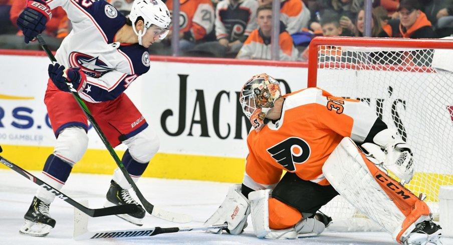 Philadelphia Flyers goaltender Brian Elliott (37) makes a save as Columbus Blue Jackets center Alexandre Texier (42) reaches for rebound during the first period at Wells Fargo Center.