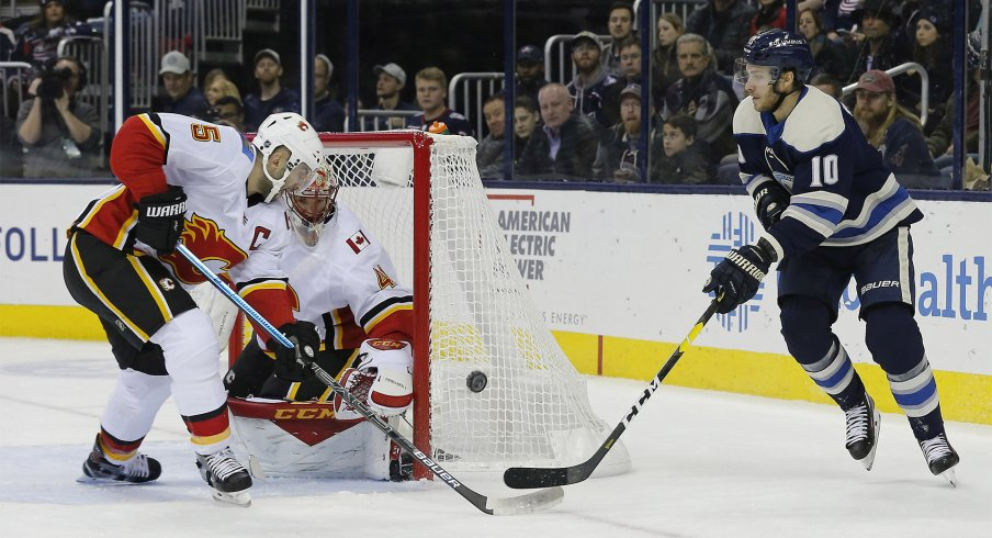 Calgary Flames defenseman Mark Giordano (5) knocks down the shot of Columbus Blue Jackets center Alexander Wennberg (10) during the second period at Nationwide Arena.