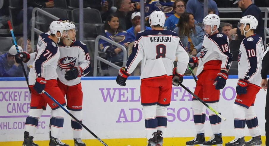 Nov 1, 2019; St. Louis, MO, USA; Columbus Blue Jackets right wing Oliver Bjorkstrand (28) is congratulated by teammates after scoring a goal against the St. Louis Blues during the second period at Enterprise Center. Mandatory Credit: Billy Hurst-USA TODAY Sports