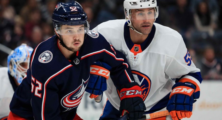 Oct 19, 2019; Columbus, OH, USA; Columbus Blue Jackets center Emil Bemstrom (52) skates against New York Islanders defenseman Johnny Boychuk (55) in the second period at Nationwide Arena.