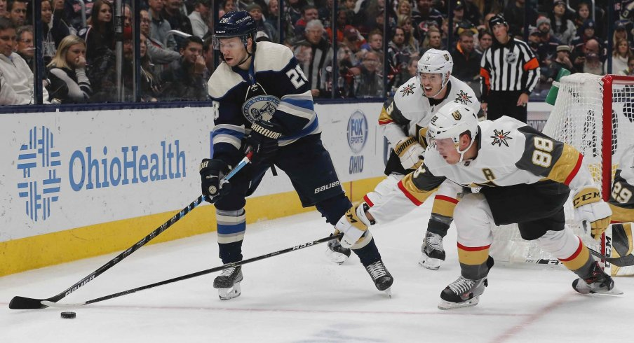 Nov 5, 2019; Columbus, OH, USA; Vegas Golden Knights defenseman Nate Schmidt (88) reaches to steal the puck from Columbus Blue Jackets right wing Oliver Bjorkstrand (28) during the second period at Nationwide Arena.