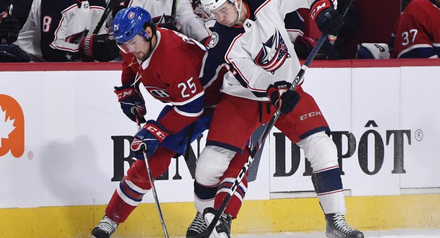 Nov 12, 2019; Montreal, Quebec, CAN; Montreal Canadiens forward Ryan Poehling (25) battles with Columbus Blue Jackets forward Emil Bemstrom (52) for possession of the puck during the second period at the Bell Centre.