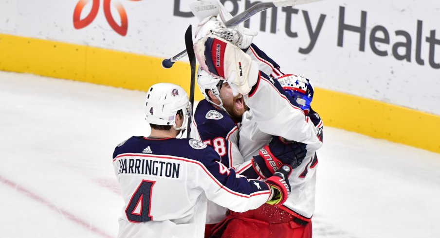 Columbus Blue Jackets goaltender Joonas Korpisalo (70) celebrates with teammates after defeating the Arizona Coyotes at Gila River Arena.