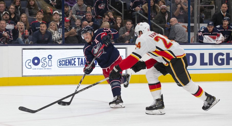 Cam Atkinson shoots during a power play against the Calgary Flames