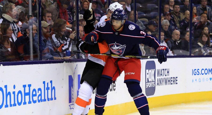 Feb 28, 2019; Columbus, OH, USA; Columbus Blue Jackets defenseman Seth Jones (3) checks Philadelphia Flyers defenseman Travis Sanheim (6) along the boards in the first period at Nationwide Arena.
