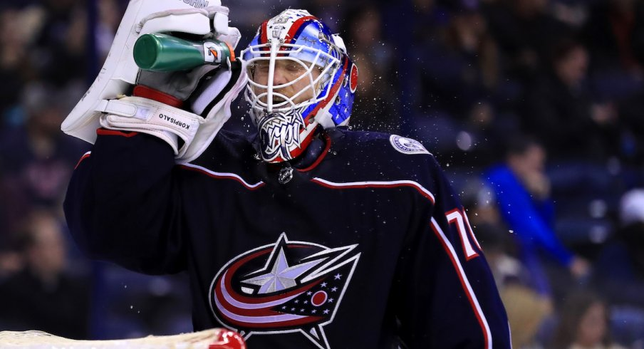 Columbus Blue Jackets goaltender Joonas Korpisalo hydrates during a stoppage in play at Nationwide Arena.
