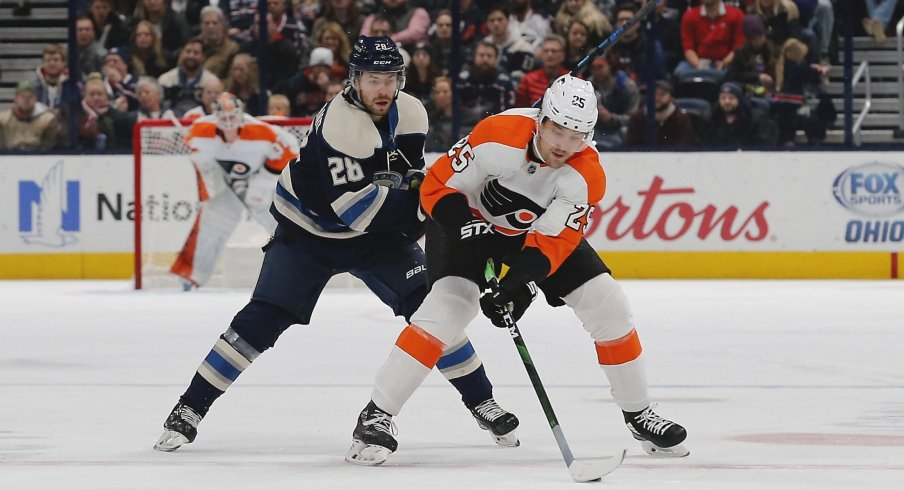 Nov 27, 2019; Columbus, OH, USA; Philadelphia Flyers left wing James van Riemsdyk (25) skates with the puck as\Columbus Blue Jackets right wing Oliver Bjorkstrand (28) trails the play during the first period at Nationwide Arena.
