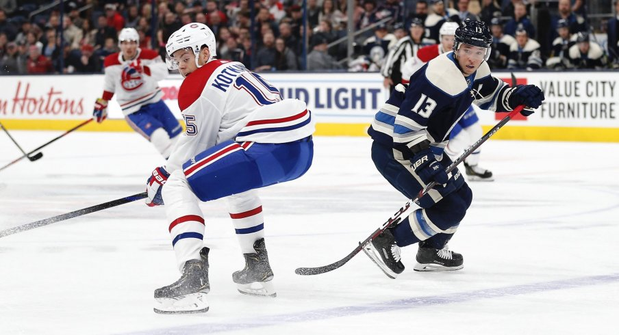 Nov 19, 2019; Columbus, OH, USA; Columbus Blue Jackets right wing Cam Atkinson (13) chips the puck past Montreal Canadiens center Jesperi Kotkaniemi (15) during the first period at Nationwide Arena.