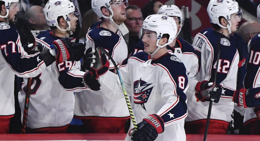 Columbus Blue Jackets defenseman Zach Werenski (8) reacts with teammates after scoring a goal against the Montreal Canadiens during the third period at the Bell Centre.