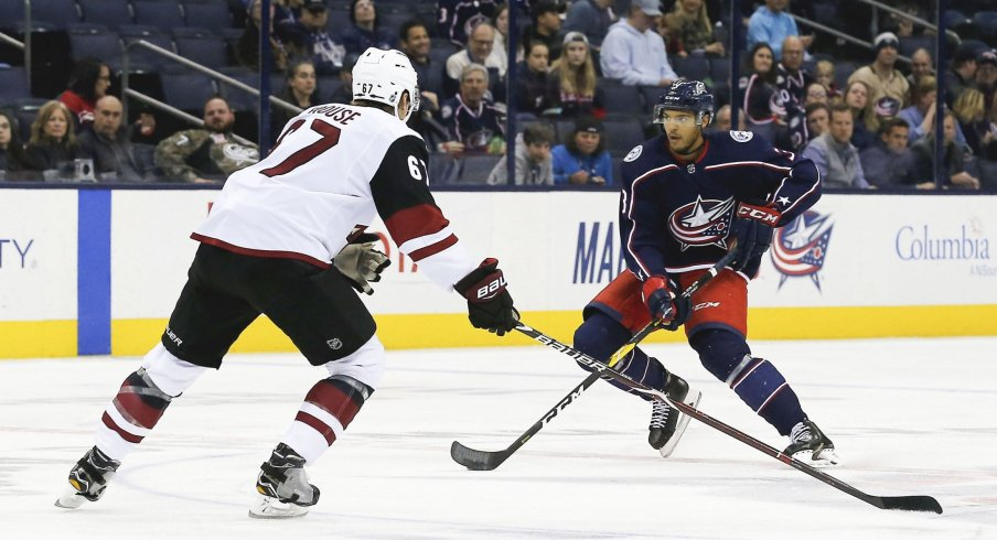 Oct 23, 2018; Columbus, OH, USA; Columbus Blue Jackets defenseman Seth Jones (3) carries the puck as Arizona Coyotes left wing Lawson Crouse (67) defends during the first period at Nationwide Arena.