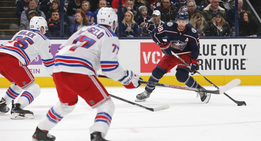 Dec 5, 2019; Columbus, OH, USA; Columbus Blue Jackets center Boone Jenner (38) shoots the puck against the New York Rangers during the first period at Nationwide Arena.