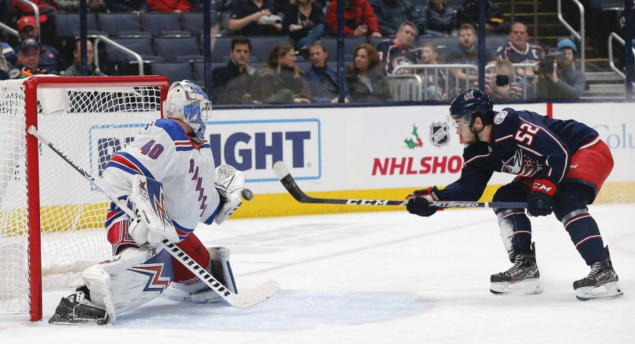 Dec 5, 2019; Columbus, OH, USA; New York Rangers goalie Alexandar Georgiev (40) makes a save against Columbus Blue Jackets center Emil Bemstrom (52) during the first period at Nationwide Arena.
